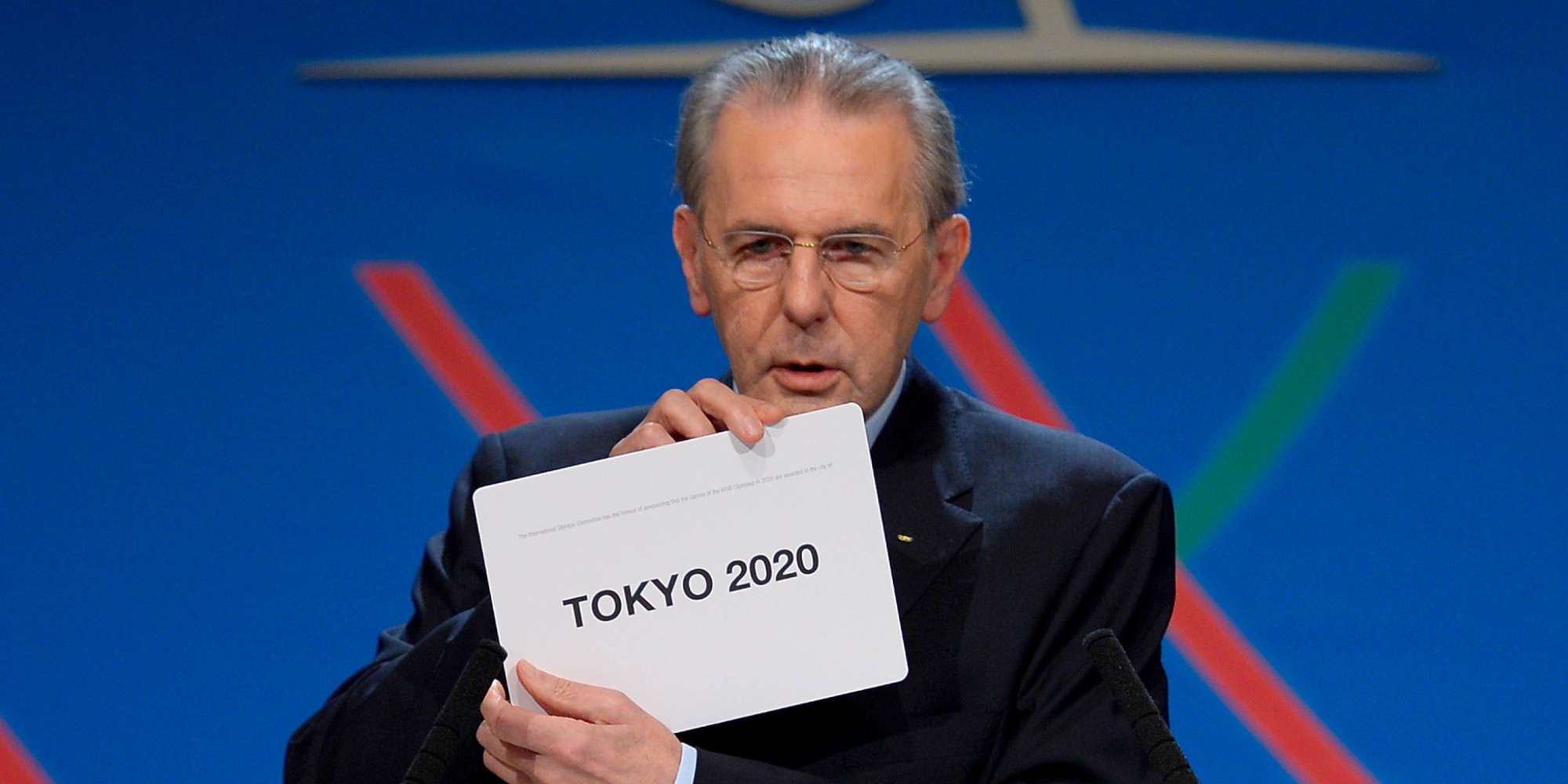 International Olympic Committee (IOC) President Jacques Rogge shows the name of the city of Tokyo elected to host the 2020 Summer Olympics in Buenos Aires, Argentina, Saturday, Sept. 7, 2013.  (AP Photo/Fabrice Coffrini, Pool)